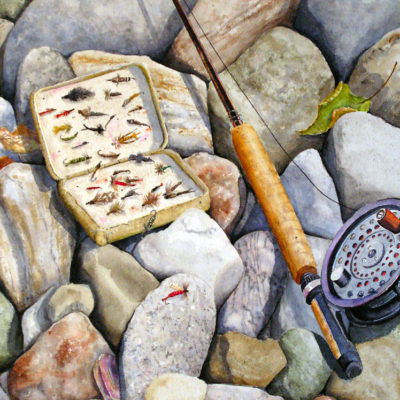 Fly fishing equipment on the rocks.