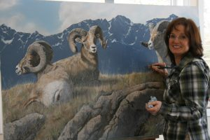 Artist Valerie Rogers painting Big Horn Sheep